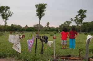 Yakye Axa children look at their ancestral land