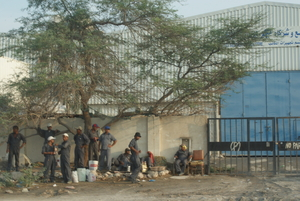 Migrant workers in Doha's industrial area October 2012