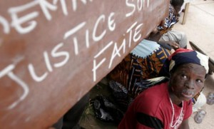 159461_a_woman_protests_outside_the_law_courts_in_abidjan