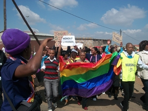 South Africa LGBTI rights activist with rainbow flag