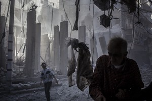 Assad loyalists shell two buildings in Aleppo