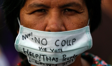 A demonstrator takes part in a protest against military rule in Bangkok