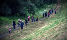 "A group of migrants from Syria walk towards the border with Hungary, near the northern Serbian village of Martonos, near Kanjiza, on June 25, 2015.Hungary said it has indefinitely suspended the application of a key EU asylum rule in order ""protect Hungarian interests"", prompting Brussels to seek immediate clarification. Illegal immigrants cross Serbia on their way to other European countries as it has land access to three members of the 28-nation bloc -- Romania, Hungary and Croatia.  AFP PHOTO / ANDREJ ISAKOVIC        (Photo credit should read ANDREJ ISAKOVIC/AFP/Getty Images)"
