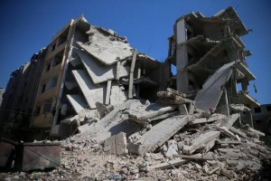 csm_194638_Destroyed_buildings_in_Zamalka__Syria_in_September_2013_46d7457f55