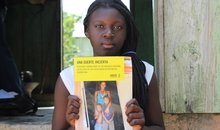 "Elisa Garcia is a young Dominican of Haitian descent rendered stateless following a controversial constitutional ruling in 2013. Like her, thousands of Dominicans of Haitian descent are now struggling to have their Dominican nationality recognized in the DR. Elisa is holding an Amnesty International report. Hundreds of thousands of Haitian migrants and Dominicans of Haitian descent face the risk of deportation from the Dominican Republic after the enforcement of a new immigration law. Dominican officials say anyone lacking identity documents or who has not registered for a so-called ""regularization"" program before the Wednesday 17th June 2015 deadline could face deportation. Over the last century an untold number of Haitians have crossed into the more prosperous Dominican Republic to escape political violence or seek a better life, many working as sugar cane cutters, house cleaners or babysitters Amnesty International said it was concerned many Dominican-born people with a legitimate right to stay could be removed because they lack documentation."