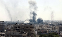 Smoke billows from buildings following an Israeli military strike east of Rafah in the southern Gaza Strip, on August 1, 2014. Israeli shelling killed eight people in southern Gaza, medics said, just hours after a 72-hour humanitarian ceasefire took effect. AFP PHOTO/ SAID KHATIB (Photo credit should read SAID KHATIB/AFP/Getty Images)