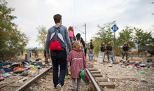 Refugees and migrants cross the border from Greece into Macedonia, near the village of Idomeni, Greece, 24 August 2015. For many thousands of migrants heading to Europe from the Middle East, from Syria and Iraq, the long route to a new life now lies through Greece and the Western Balkans.