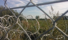 These pictures and video footage show the situation at the Hungarian and Serbian border after Hungary sealed the border. Photograph taken by Amnesty International Hungary representative at the Roszke ? Horgos border crossing between Serbia and Hungary. On Wednesday 16th September 2015 hundreds of trapped refugees briefly broke through a border gate on the now-blocked Hungarian border, leading to frenzied clashes with Hungarian police. Tensions boiled over after thousands of refugees fleeing wars in Syria, Iraq and Afghanistan began arriving at the Horgo? border crossing between Serbia and Hungary, in the hours after Budapest finally sealed it following months of threats to do so. Now Hundreds of refugees and migrants remain trapped in abysmal and rapidly deteriorating conditions in Serbia, near the border with Hungary.