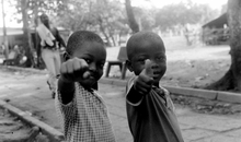 A sign of hope from displaced children of the Cacarica River Basin in the Turbo Sports Grounds.