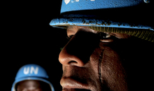 Members of the Nigerian battalion of the United Nations-African Union Hybrid Mission in Darfur (UNAMID) prepare for a night patrol security exercise through the camps of the Internally Displaced Persons, El Geneina, Sudan, 14 March 2008.