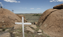 Marikana, scene of the killings of 34 people, most of them miners, on 16 August 2012, during a strike at the platinum mine run by Lonmin. Thirty-four people were killed after police opened fire on striking miners at a South African mine. The Lonmin-owned platinum mine has been at the centre of a violent pay dispute, exacerbated by tensions between two rival trade unions. Violence had already killed 10 people, including two police officers, since the strike began, The Association of Mineworkers and Construction Union (AMCU) accused the police of carrying out a massacre.