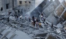 Palestinians inspect the remains of Al-Basha, a building that was destroyed by an Israeli air strike in Gaza City on August 26, 2014. An Israeli air raid in Gaza killed two Palestinians Tuesday, as Israel pursued its campaign to stop rocket fire by Hamas militants from the enclave, medics said. AFP PHOTO / MOHAMMED ABED (Photo credit should read MOHAMMED ABED/AFP/Getty Images)