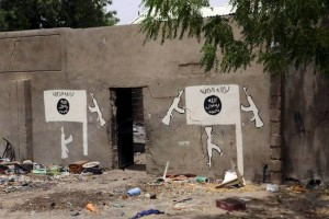 csm_209149_A_wall_painted_by_Boko_Haram_is_pictured_in_Damasak_3ee2430580