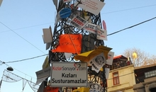 A tower in Istanbul where most demonstrations end up covered in placards and signs at an internet freedom demonstration.