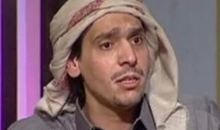 Qatari poet Mohammed al-Ajami during a television interview. Mohammed al-Ajami, also known as Mohammed Ibn al-Dheeb, is currently (2014) serving a 15-year prison sentence for writing and reciding a poem deemed critical of the Qatari ruling family. He was originally sentenced to life imprisonment in 2012, but in 2013 this was overturned on appeal. He is a prisoner of conscience.