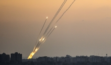 A picture taken from the southern Israeli city of Sderot shows rockets being fired from the Gaza strip into Israel, on July 13, 2014. A rocket fired from Syria hit the Israeli-occupied sector of the Golan Heights on July 13, 2014, falling on open ground and causing no casualties, an army spokeswoman told AFP. AFP PHOTO / JACK GUEZ (Photo credit should read JACK GUEZ/AFP/Getty Images)