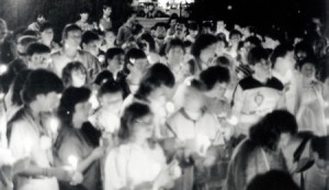 Black and white photograph showing a candlelit vigil for people who have disappeared in Venezuela. Vigil organised by Amnesty International and participants are mainly AI members.