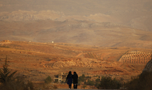 (AUSTRALIA & NEW ZEALAND OUT) Two women walk through the outskirts of Brital village in the Bekaa Valley, Lebanon, where the nearby mountain range borders Syria, October 11, 2014. Six days earlier, members of the Islamic Front attacked Hezbollah soldiers defending the village. (Photo by Kate Geraghty/The Sydney Morning Herald/Fairfax Media via Getty Images).