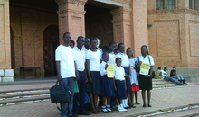 The students at the Saints Peter and Paul Cathedral of Lubumbashi, Democratic Republic of Congo, 17 March 2013, after writing letters for supporting Amnesty International's Arms Trade Treaty campaign.