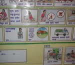 "The government of Nepal issues cards with guidance on what to do during pregnancy and danger signs to look for. This is a poster version of the information on what to do to help ensure a safe pregnancy. Photo taken in a ""birthing centre"" built by an NGO in Mugu district."