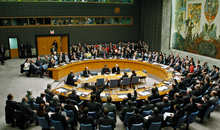 Fourteen members of the Security Council vote in support of a resolution calling for an immediate ceasefire in Gaza leading to a full Israeli withdrawal, the unimpeded distribution of food, fuel, medical treatment, and intensified international arrangements to prevent arms and ammunition smuggling in the territory, with one member abstaining, United Nations, New York, 8 January 2009.