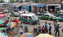 Minibuses wait for passengers on a busy thoroughfare in Brazzaville on October 24, 2015, ahead of tomorrow's controversial referendum allowing the longtime Congolese president to seek a third term. The country has been rocked by weeks of protests ahead of a planned referendum on October 25 to amend the constitution that would enable veteran ruler Denis Sassou Nguesso to remain in office.