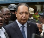 Haiti's ex-dictator Jean-Claude Duvalier is escorted out of his hotel, Port-au-Prince