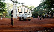 Photograph taken by Amnesty International's Crisis Response Advisor, Joanne Mariner during a recent mission to the country. The visit was to investigate the protection of civilians amid escalating waves of sectarian attacks in the central regions of Central African Republic. Photograph shows the catholic church in Dekoa and a United Nations armoured vehicle in front. The Amnesty team arrived on the 24th October and found that the entire Christian andanimist population of the town had been displaced, with about 1,700 people living in the Catholic Church compound (transformed into an internally displaced people's camp), and many more living in the bush. Serious human rights abuses are being committed in the Central African Republic (CAR), including killings, mutilation of bodies, abductions, and forced displacement. The United Nations Multidimensional Integrated Stabilization Mission in the Central African Republic (MINUSCA), deployed on 15 September 2014, has not yet been able to stop or prevent most of these abuses. Those responsible, including members of the Séléka, Anti-balaka, and their allies continue to enjoy impunity. On 10 October 2014, the prompt intervention of French forces aided by UN peacekeepers prevented a large-scale massacre in Dekoa. Yet with international forces stretched thin—in part because MINUSCA is still several thousand troops short of its mandated numbers—they have not been able to prevent escalating violence in the country's central region.