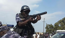 A police officer fires tear gas at pro-Mbabazi supporters in Jinja. As Uganda's February 2016 presidential and parliamentary elections approach, in what will be President Yoweri Museveni's 30th year in power, police have disrupted peaceful opposition gatherings using excessive force, arbitrarily arrested opposition politicians, and tortured individuals aligned with the opposition. Restrictions on freedom of assembly hindered the ability of Ugandans to receive information and engage with politicians, before presidential campaigns started in November 2015.
