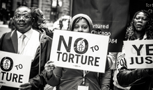 Activists march with Chicago torture survivors at Amnesty International USA's 2014 human rights conference in Chicago, Illinois