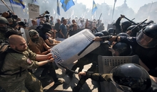 KIEV, UKRAINE - AUGUST 31: Protestors clash with National Guards troops nearby Verkhovna Rada building on August 31, 2015 in Kiev, Ukraine. 120 were wounded and 1 is dead in clashes after lawmakers gave initial approval to changes of Constitution of Ukraine granting more autonomy to pro-Russian separatists in eastern Ukraine Attackers threw a hand grenade at National Guard troops guarding the building of Rada.