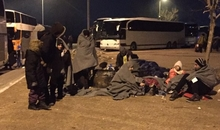 Refugees, asylum seekers and migrants are sleeping out in the open in a petrol station in northern Greece while there is a transit camp with heated shelter 20 Km away in Idomeni. The police is restricting access to the Idomeni camp despite it has capacity to receive people. Photo taken in January where temperatures were dropping to minus zero.