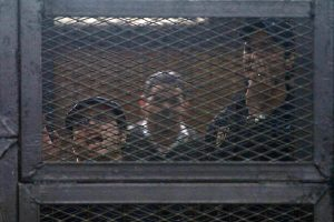Egyptian prominent activists Ahmed Douma (R) and Ahmed Maher (L), the founder of the April 6 youth movement that led the revolt against ousted president Hosni Mubarak, react as they stand in the accused dock during their trial in the capital Cairo on April 7, 2014. An Egyptian appeals court today upheld three-year prison sentences for the three activists charged with violating a controversial law restricting protests. AFP PHOTO / HASSAN MOHAMED (Photo credit should read HASSAN MOHAMED/AFP/Getty Images)