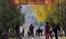 School girls sweep a street near a polling station at their school building in the village of Gornaya Mayevka, some 30 km outside Bishkek, on October 2, 2015. Kyrgyzstan's parliamentary election will be held on October 4, 2015.