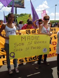 "Espacio Feminista de Esquipulas, Nicaraga Two girls hold a banner which says ""Motherhood: Only if I am willing, only if I can"" 28 September, 2011, Managua, Nicaragua."