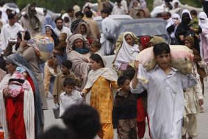 Civilians from Maidan, Lower Dir, northwest Pakistan, reaching Timergara after fighting forced them to leave their homes, 27 April 2009.